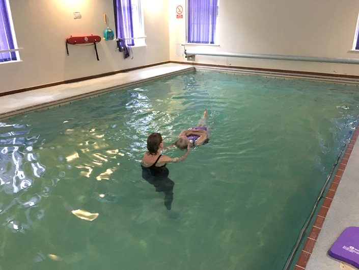 Frances, 82 years, performing back crawl leg kick and a back star float - previously Frances was a non-swimmer, very nervous and scared of the water