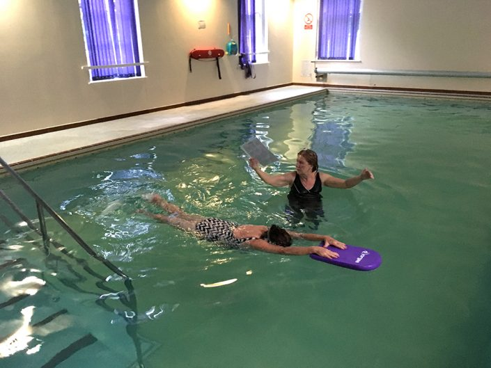 Bernadette performing Front Crawl leg kick....previously Bernadette was unable to put her face into the water and exhale