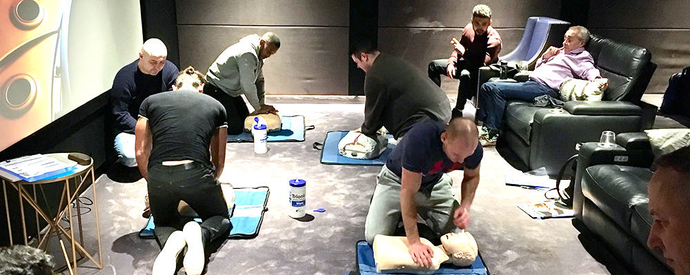 Total Fit staff performing CPR on the recent Pool Emergency Responder course
